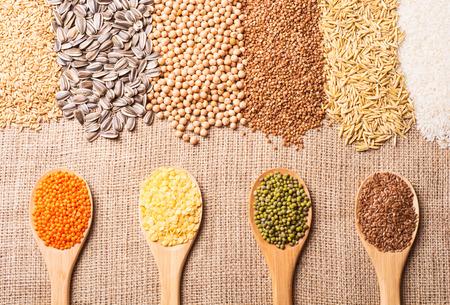 Cereal grains , seeds, lentil, beans on wooden background.