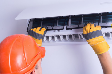 Placing back clean filter into air conditioner