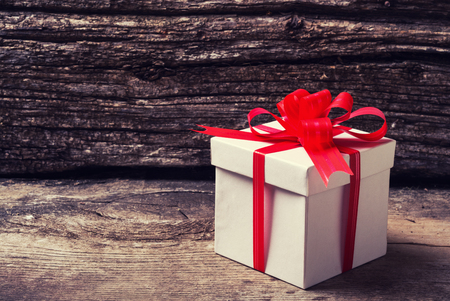 Christmas presents with gift box on wooden background .