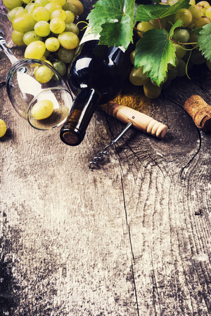 vins: Bottle of white wine , grape and corks on old wooden background Stock Photo
