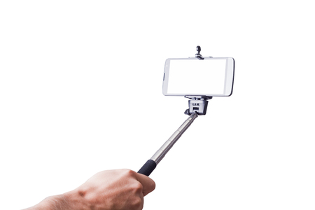 selfie monopod and cellphone. Isolated on white background