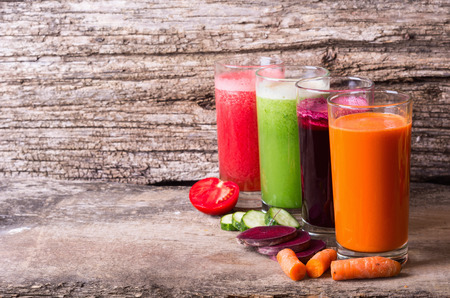 Juice with vegetables ( carrots, beets, tomatoes and cucumbers ) Stock Photo - 45363640