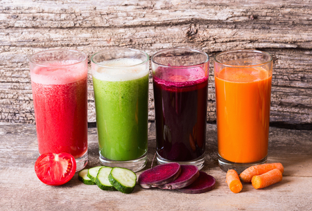 Juice with vegetables ( carrots, beets, tomatoes and cucumbers ) Banco de Imagens - 45363724