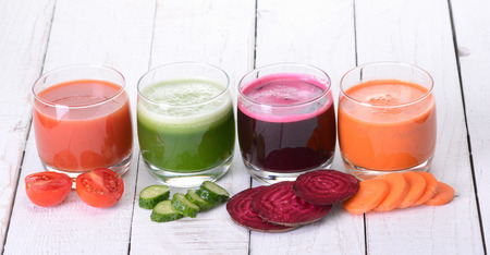 green and purple vegetables: Vegetable juice ( carrot , beet , cucumber , tomato ) Stock Photo