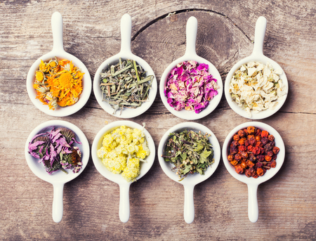 dried flowers: Nature medicine . Herbs on wooden background . Stock Photo