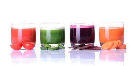 Vegetable juice (carrot, beet, cucumber, tomato). Isolated on white background