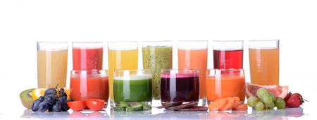 cocktail glasses: Fruit juice ( grape , strawberries , orange , kiwi , grapefruit , apple ) & vegetable juice ( tomato . cucumber , beets , carrots ) Stock Photo