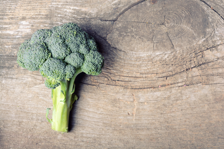 brocoli: Bunch of fresh green broccoli on wooden background