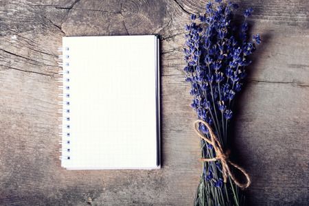 lavander: bunch of lavander & notebook on wooden background