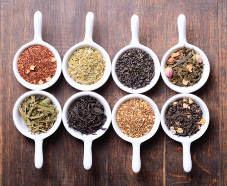 teas: assortment of dry tea on wooden background