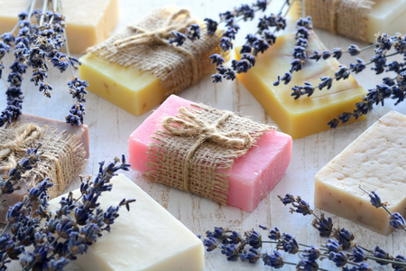 Collection of handmade soap on wooden background