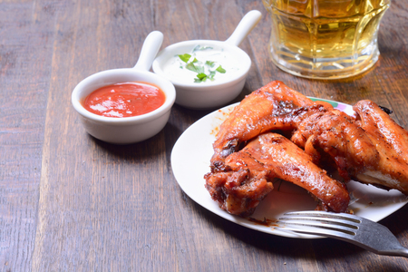 baked meat: Baked meat wings on wooden background