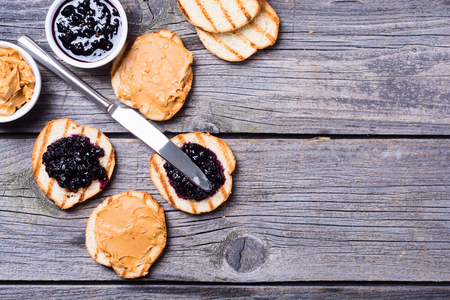 Peanut butter and jam sandwich on rustic wooden background Stock Photo