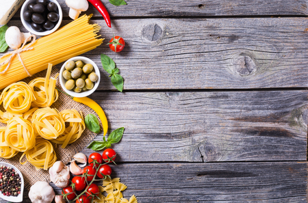 Italian food : Ingredient for cooking pasta . Top view with space for text