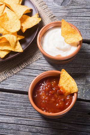 nacho chip: Snack for party , chips , nachos with tomato sauces and tartar . Top view