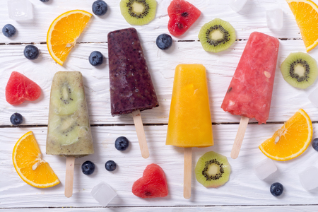 popsicles: Popsicle with kiwi , orange , blueberry and watermelon