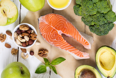 Healthy food vegetables , nuts and salmon . With vitamin omega 3 Stock Photo