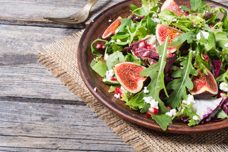 Autumn salad with arugula , spinach , figs and cheese