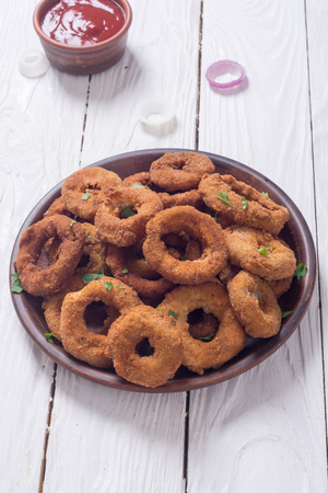 Homemade crunchy fried onion rings with sauces Stock Photo