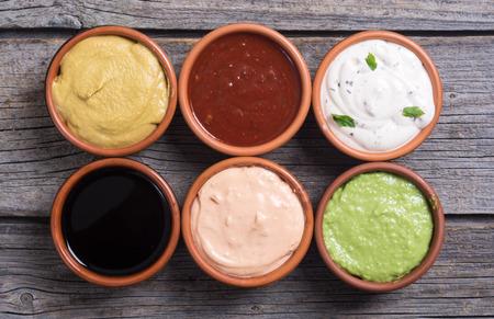 Set of sauces in bowl on wooden background Zdjęcie Seryjne