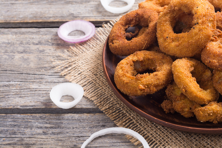 Homemade crunchy fried onion rings .