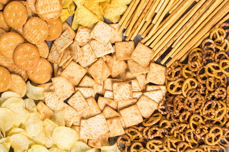 Texture . Mix of snacks : pretzels , crackers , chips and nachos