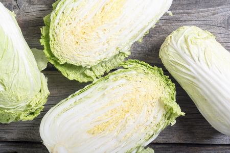 Fresh chinese cabbage on wooden bacground . Green vegetable Stock Photo