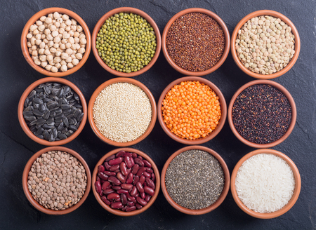 Mix of cereals and beans in bowl . quinoa , lentils , chia , chickpeas , sunflowers . Stock Photo
