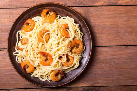 Italian pasta spaghetti with shrimps . Seafood backround