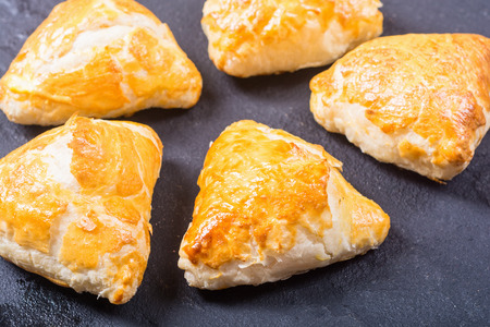 Freshly baked puff pastry samosa . Asian food