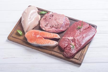 Mix of steak meat : salmon , beef , pork and chicken