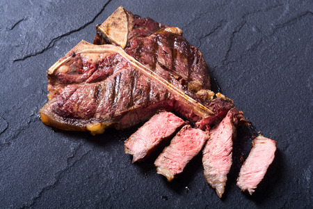 Grilled beef porterhouse steak . T-bone barbecue meat