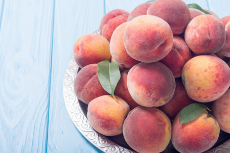 Ripe peaches fruit on rustic background . Summer healthy food