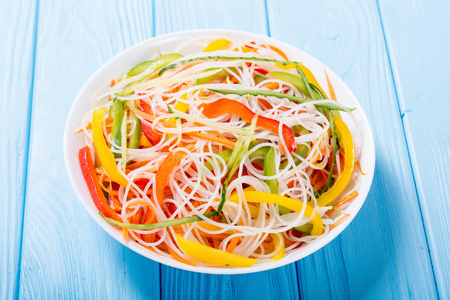 Salad from rice noodles with vegetables . Asian food