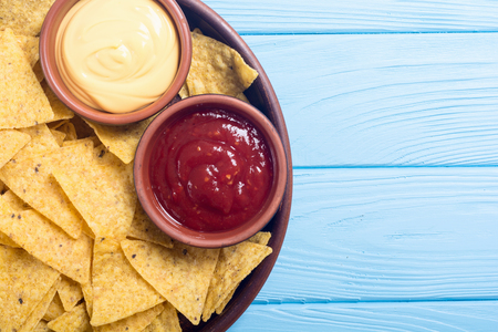 Crispy chips nachos with tomato and cheese sauce . Traditional mexican food Stock Photo