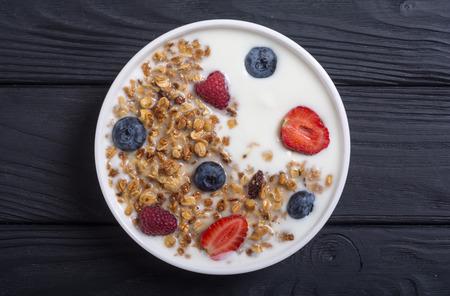 Yogurt with granola and berries  ( blueberries , strawberry, raspberry ) Stock Photo
