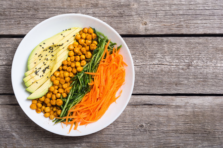 Buddha bowl with avocado , cucumber , carrot and chickpea . Healthy vegan salad food