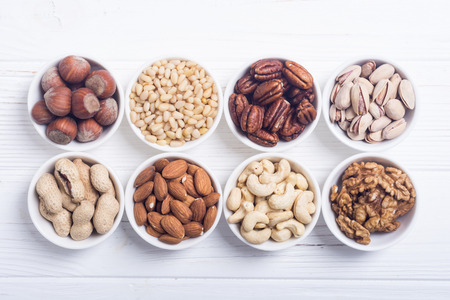 Mix of nuts : Pistachios, almonds , walnuts , pine nut , hazelnuts and cashew . Snack in bowl backgrond