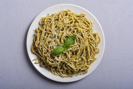 Pasta spaghetti with sauce pesto . Italian food background