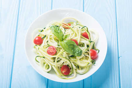 Zucchini pasta noodles with tomatoes . Healthy vegetarian food 写真素材