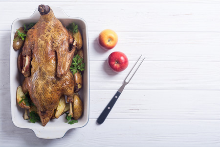 Homemade baked duck with potatoes and apple . Christmas food Stock Photo