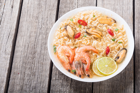 Instant noodles soup with shrimps and mussels . Asian food