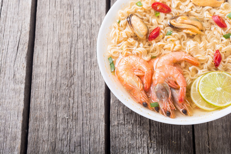 Instant noodles soup with shrimps and mssels . Asian food Stock Photo