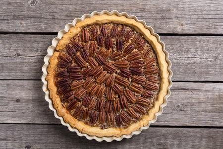 Autumn american pecan pie . Sweet dessert . Food background