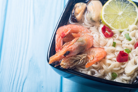 Instant noodles soup with shrimps and mssels . Asian food 免版税图像