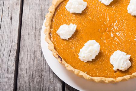Homemade american traditional pumpkin pie . Autumn food background