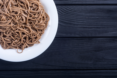 Japanese soba noodles on a plate . Asian food background 写真素材
