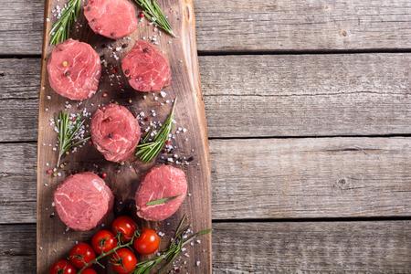 Raw filet mignon . Beef sreak on rustic background