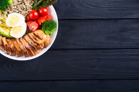 Buddha bowl salad with quinoa eggs avocado chicken and tomatoes . Yealthy detox food Stock Photo