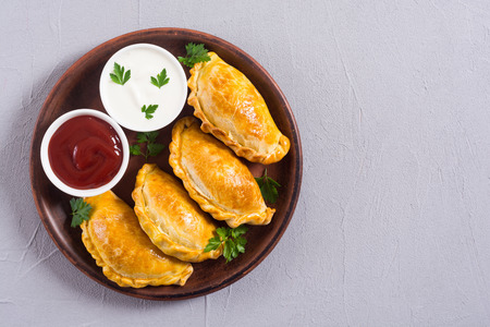 Latin American baked beef empanadas with sauces . Food background 版權商用圖片